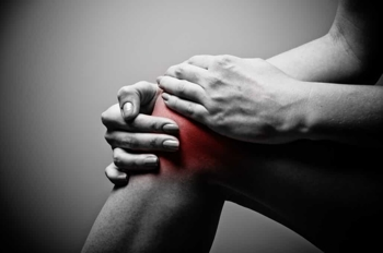 Holding Knee in Pain
